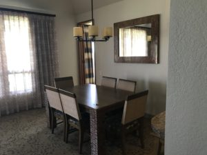 Dining area with table for 6 in 2 bedroom condo at Bay Club