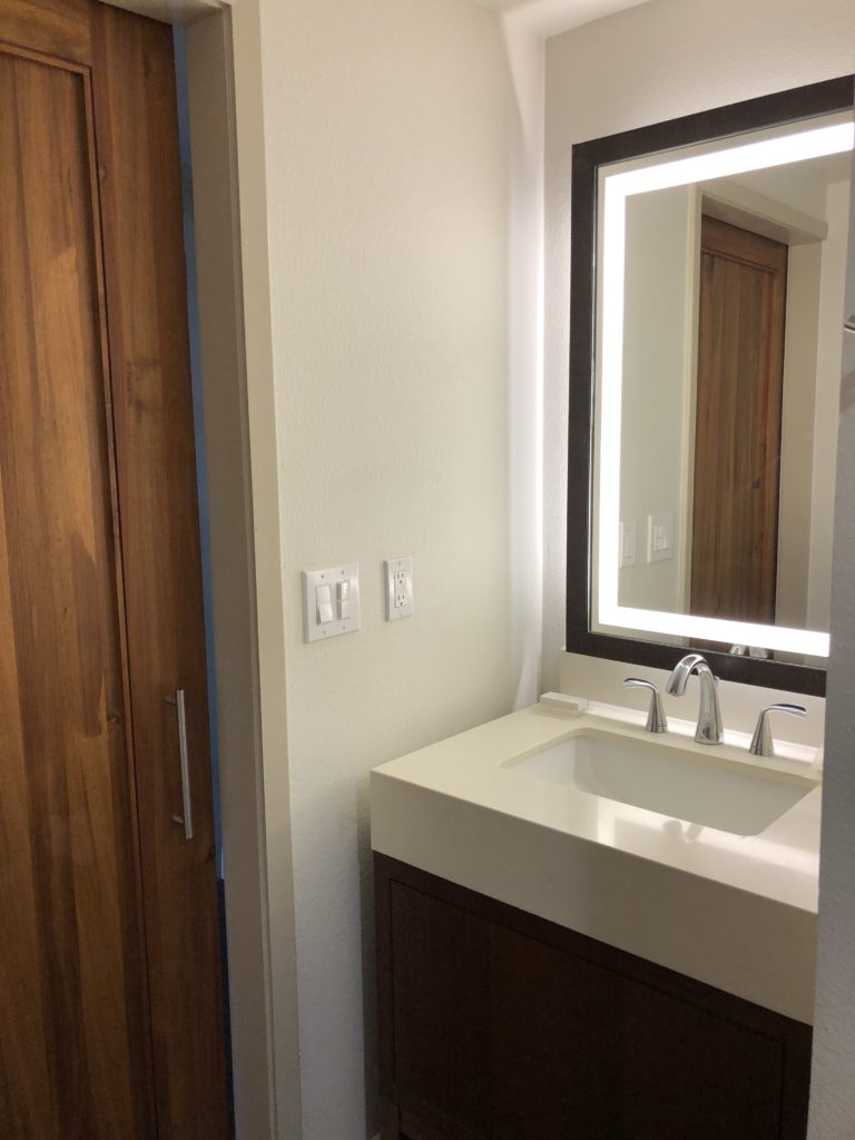 remodeled bath with barn door at Hilton Garden Inn Kauai
