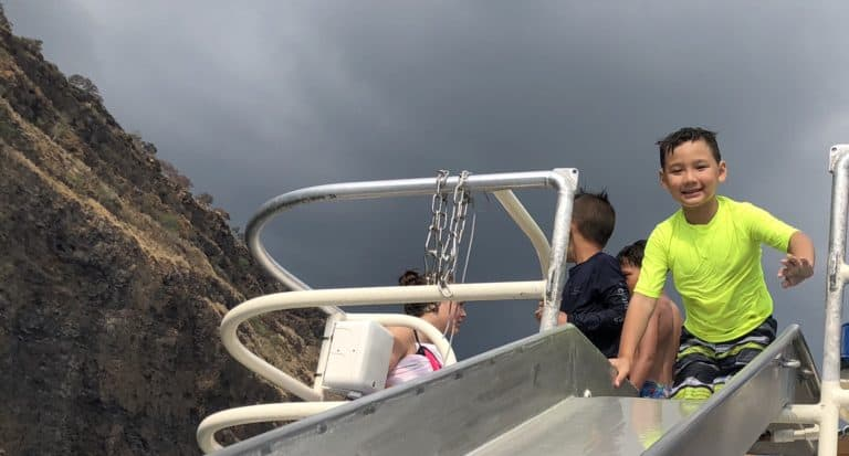 Huge slide from the top of the boat provides more fun along with the best snorkeling on the Big Island